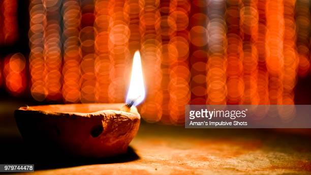 burning diya at night, india - diwali celebration stock photos and pictures