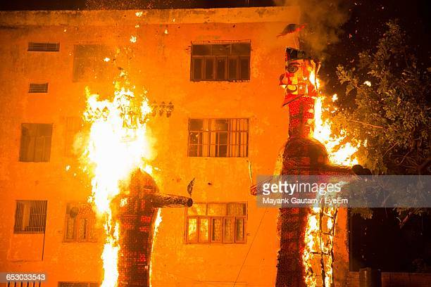 burning effigy of ravana and indrajit during dussehra - hot indian model stock pictures, royalty-free photos & images