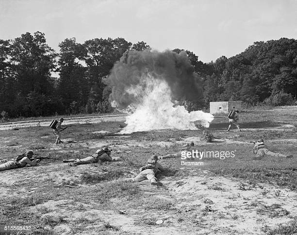 Burning 'Em Out Edgewood Arsenal Maryland Units here went through maneuvers to show methods in which chemicals are used in modern warfare In this...