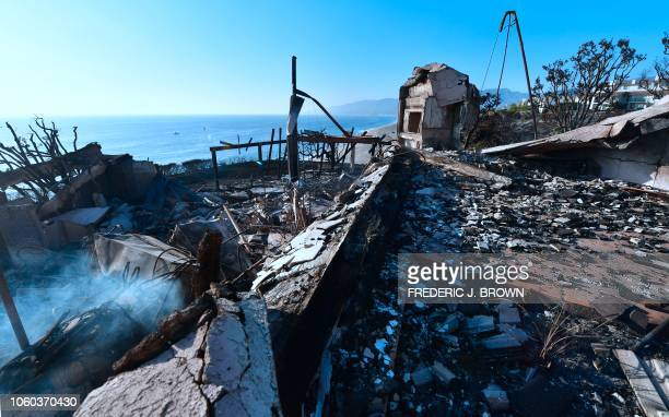 Burning embers remain amidst the destruction of a beachside luxury home along the Pacific Coast Highway community of Point Dume in Malibu California...