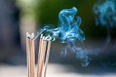 burning Embossed  sticks and smoke from incense burning and smoke