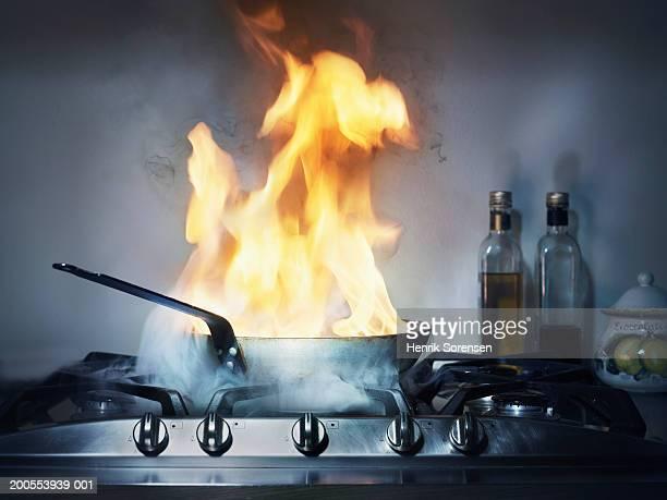 Burning frying pan in kitchen