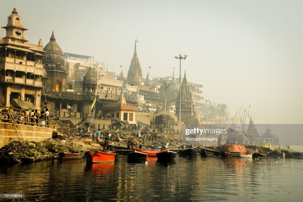 Burning ghats of varanasi with ancient temples : Stock Photo