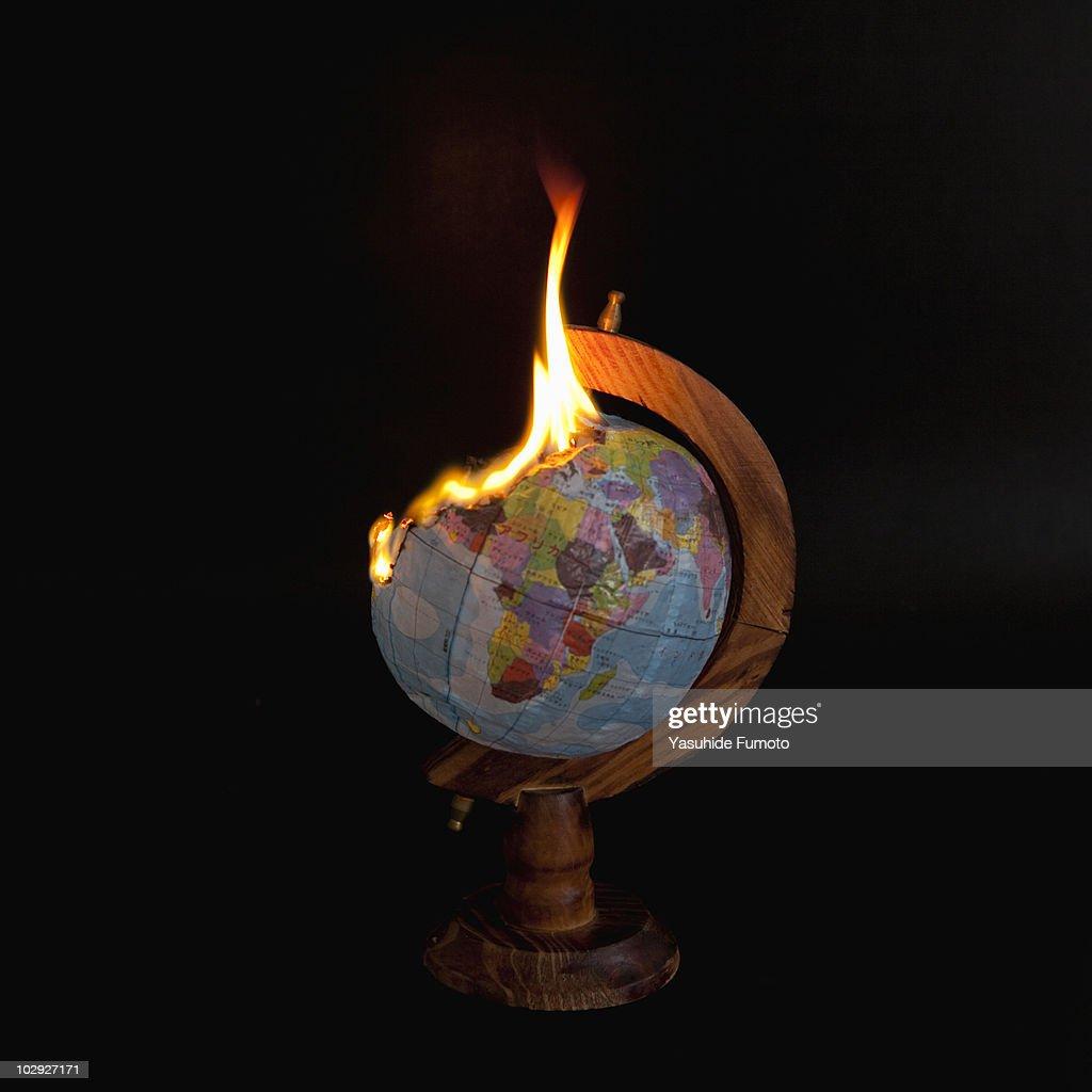 A burning globe. : Stock Photo