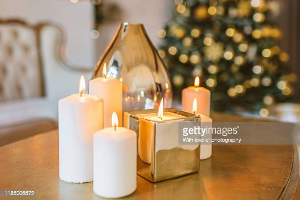 burning golden candles  living room christmas decoration, christmas background, white and gold colors, winter holidays background, interior - christmas decore candle stock pictures, royalty-free photos & images