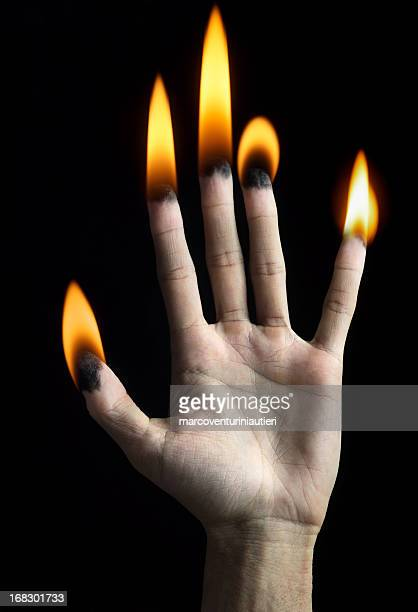 burning hand - symbolism stock pictures, royalty-free photos & images
