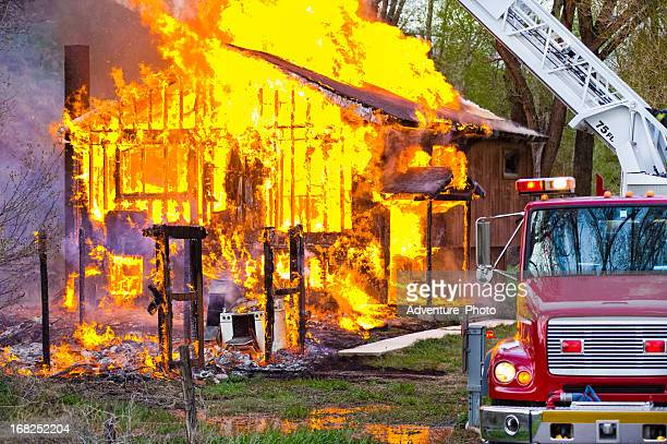 Burning House Fire with Emergency Services Truck