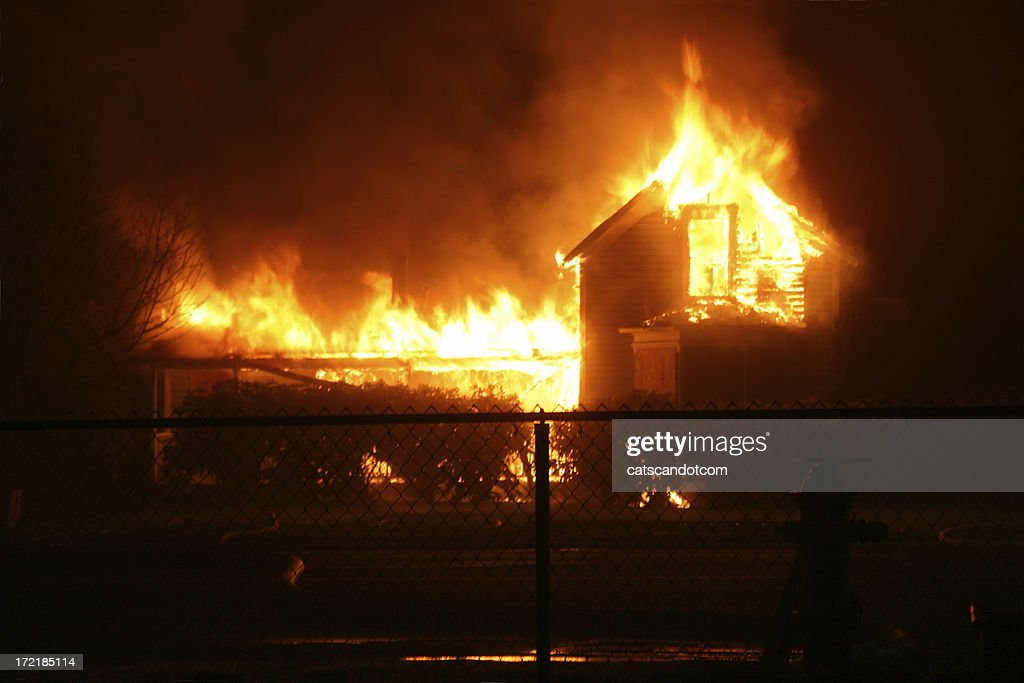 Burning House in Orting Valley at night : Stock Photo