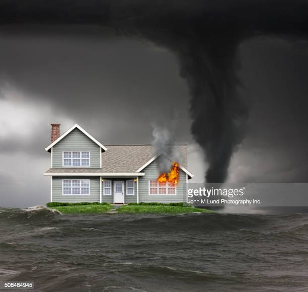 burning house on isolated island in stormy seas - california flood stock photos and pictures