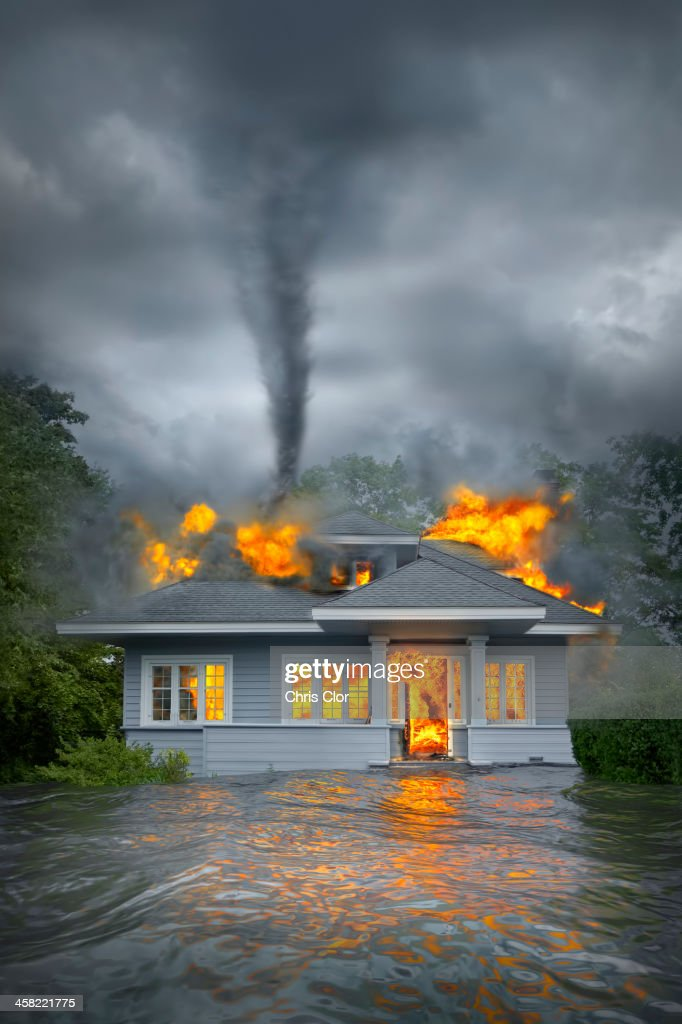 Burning house under tornado in flooded landscape : Stock Photo