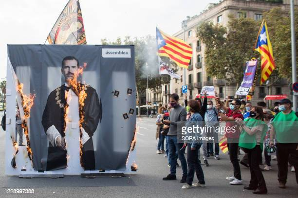 Burning image of the King Felipe VI in a flame during the demonstration. Anti-monarchical sympathizers for the independence of Catalonia have...