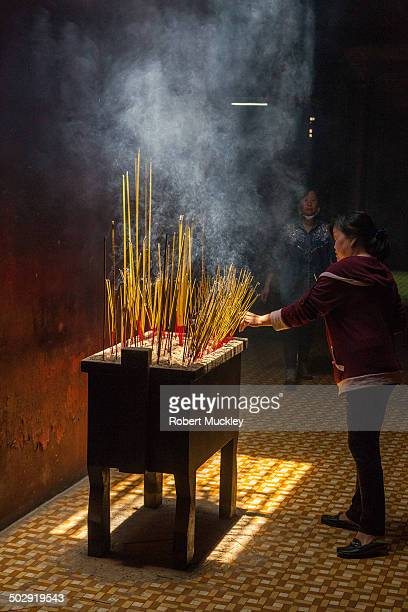 CONTENT] Burning Incense in the Khanh Nam Vien Pagoda Cjolon