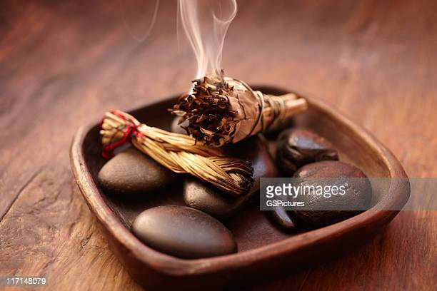 burning incense sage stick and pebbles - incense stock photos and pictures