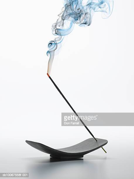 burning incense stick and tray, studio shot - incense stock photos and pictures