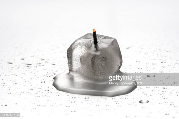 Burning incense stick in the ice cube.