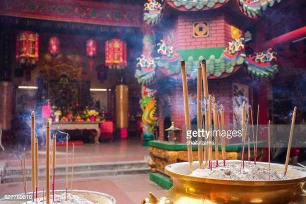 burning incense sticks - shaifulzamri stock pictures, royalty-free photos & images