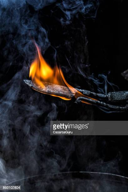 Burning Knife Blade In Forge