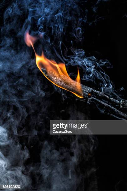 burning knife blade in forge - tongs work tool stock photos and pictures