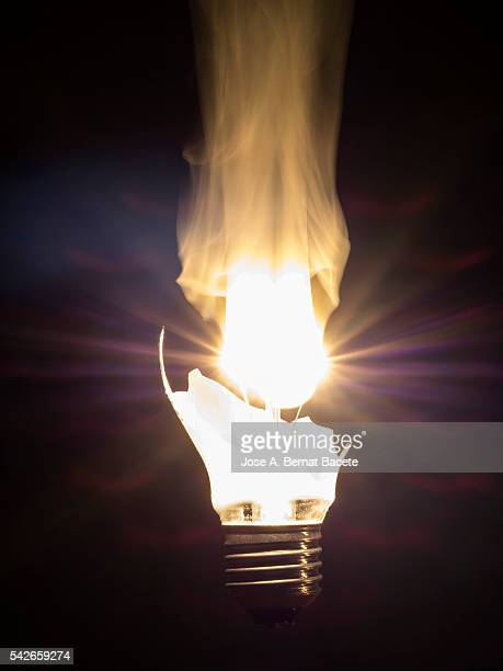 Burning lightbulb filament on a black background