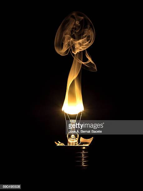 burning lightbulb filament on a black background - blackout picture stock pictures, royalty-free photos & images