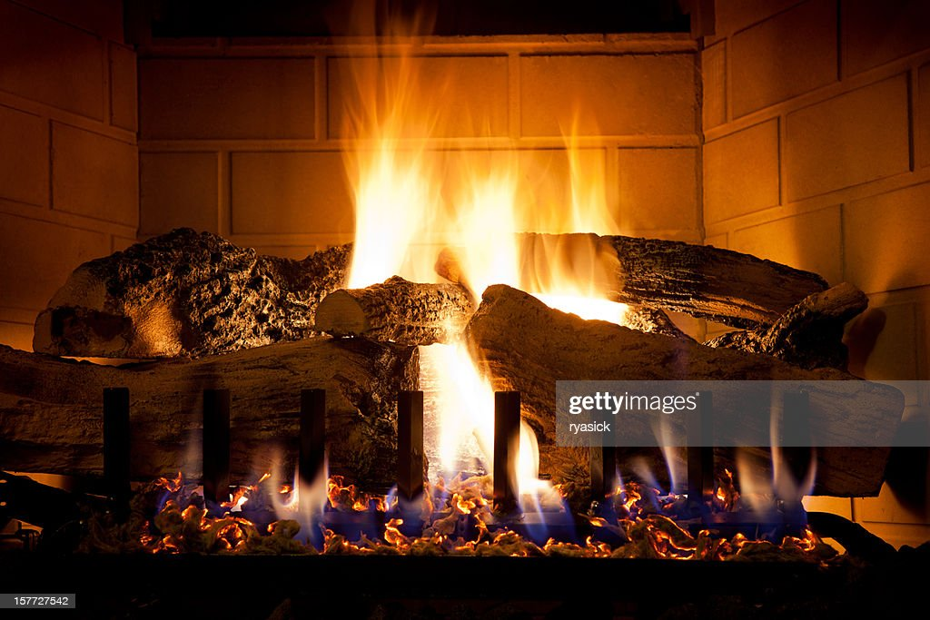View Stock Photo of Burning Logs And Glowing Embers In Gas Fireplace. Find premium