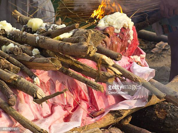 burning man - ganges river dead bodies stock photos and pictures