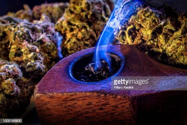 Burning marijuana in a pipe