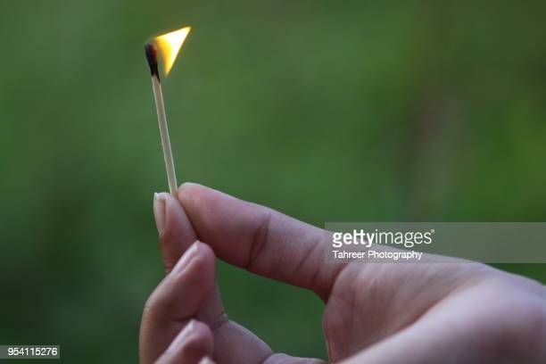 burning match stick - match lighting equipment stock photos and pictures