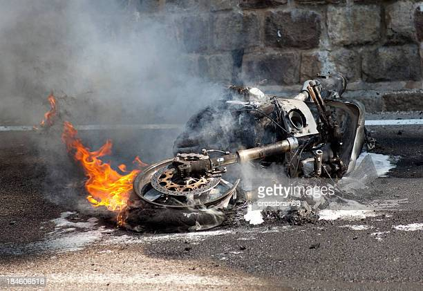 burning motorcycle after bad accident - motorcycle accident stock pictures, royalty-free photos & images