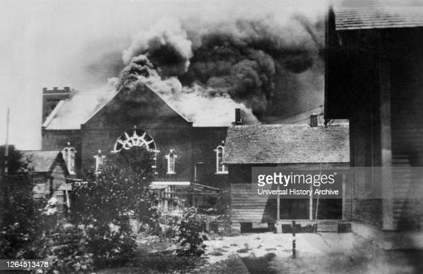 Burning of Church where Ammunition was stored during Race Riot, Tulsa, Oklahoma, USA, American National Red Cross Photograph Collection, June 1921.