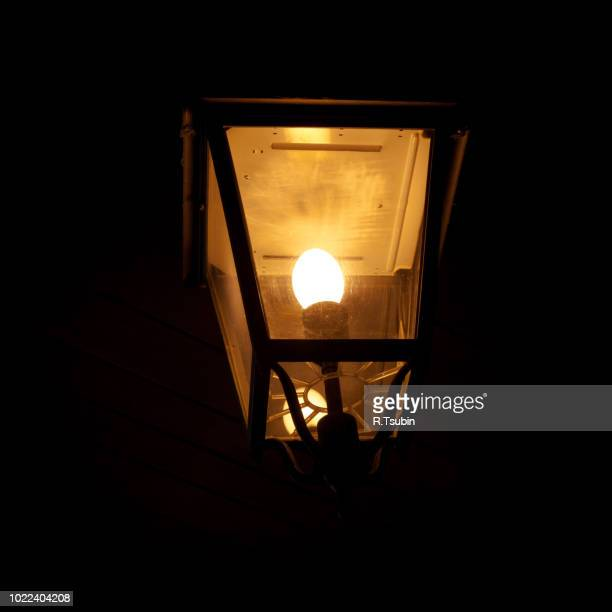 burning old lantern in the dark - candle in the dark stock pictures, royalty-free photos & images