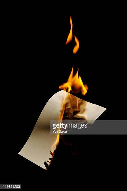 burning paper - burning stock pictures, royalty-free photos & images