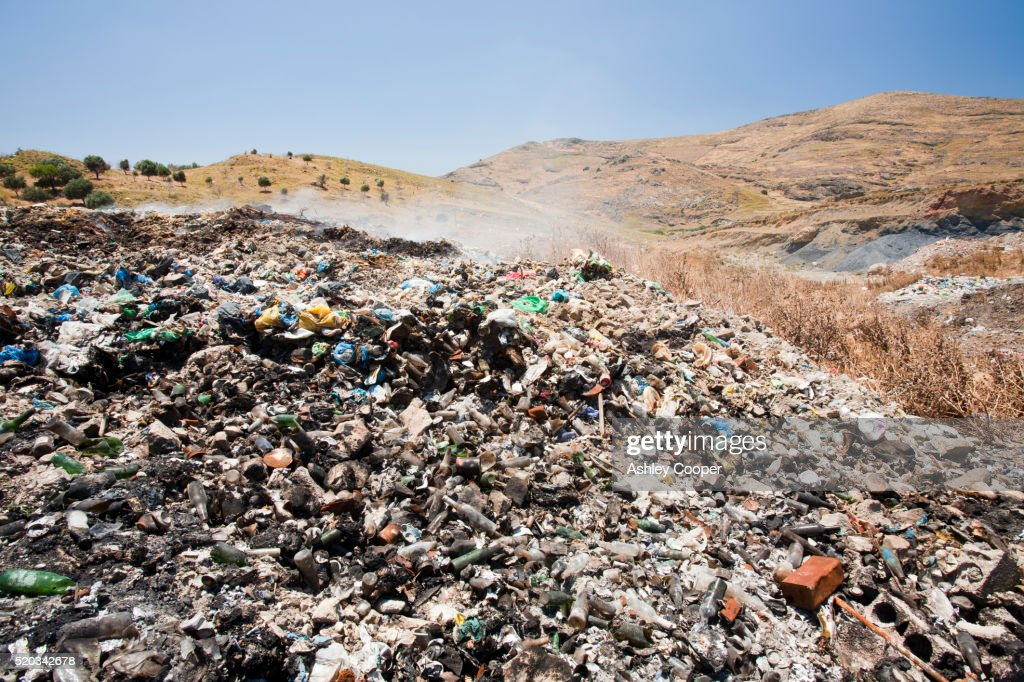 Burning plastic rubbish on a landfill site in Eresos, Lesbos, Greece. : Stock Photo