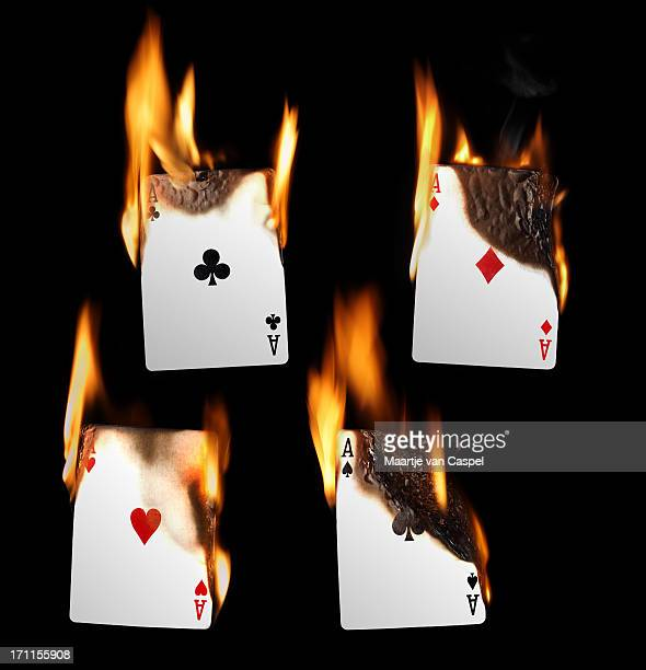burning playing cards - aces - hearts playing card stock photos and pictures