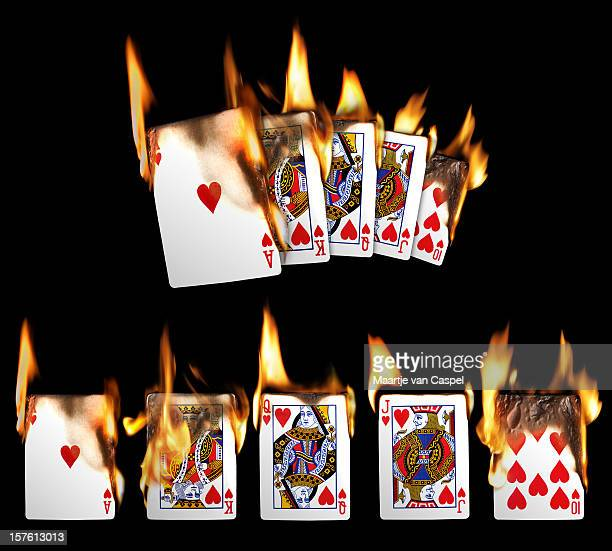 burning playing cards - royal flush - hearts playing card stock photos and pictures