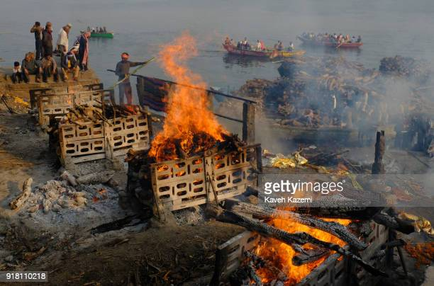 Burning pyres seen during cremation ceremonies in Manikarnika Ghat on January 28, 2018 in Varanasi, India. Manikarnika Ghat is one of the holiest...