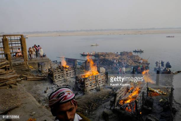 Burning pyres seen during cremation ceremonies in Manikarnika Ghat on January 28, 2018 in Varanasi, India. Manikarnika Ghat is one of the holiest...