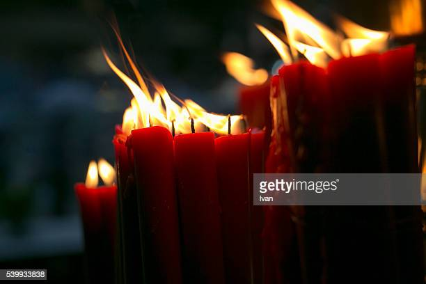 Burning Red Candle in Traditional Chinese Temple