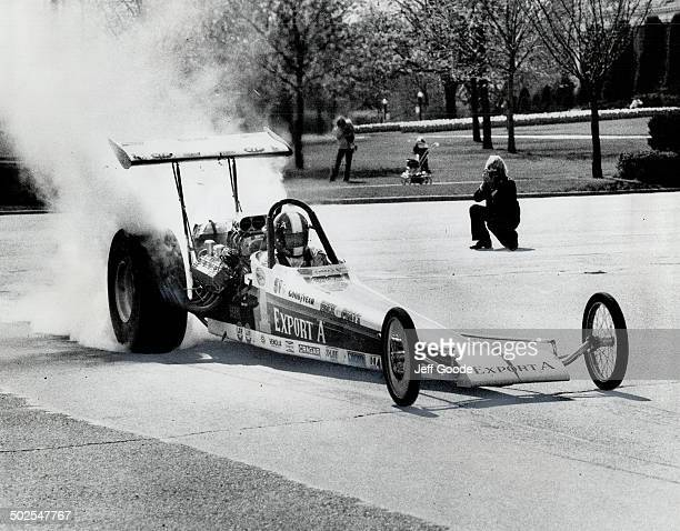 Burning rubber from rear tires of his 1800horsepower dragster at CNE yesterday Gary Beck of Edmonton shows the form which he hopes will give him the...