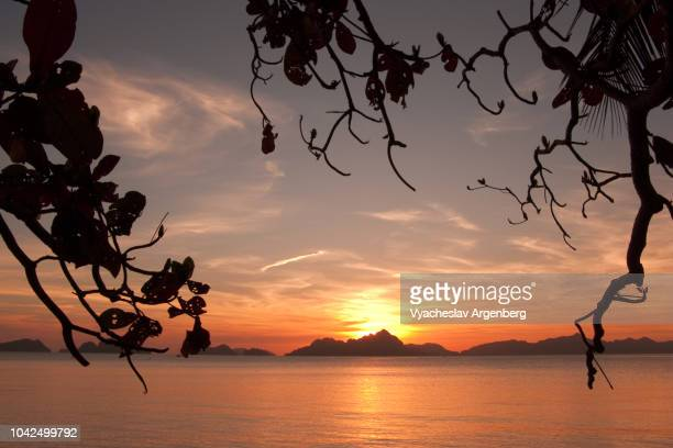 burning sunset in el nido, tropical bliss, palawan, philippines - argenberg stock pictures, royalty-free photos & images