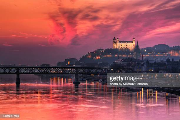burning sunset over bratislava castle - bratislava stock pictures, royalty-free photos & images