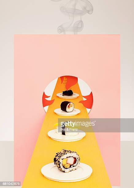 burning sushi - conveyor belt stock pictures, royalty-free photos & images