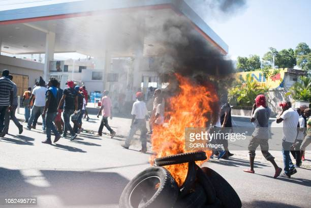 Burning tires in the streets as tens of thousands of protesters march down the streets Protesters gathered to demonstrate against the $38 billion...
