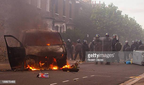 CONTENT] Burning van and London Metropolitan Riot police on Goulton Road Hackney London