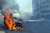 Burning van with large flames and black smoke