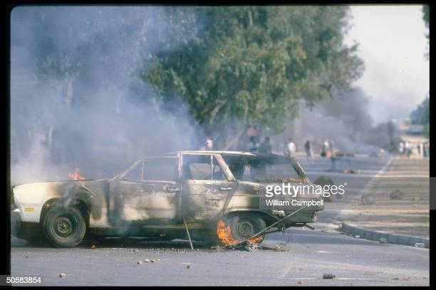 Burning vehicle during racial unrest in black townships