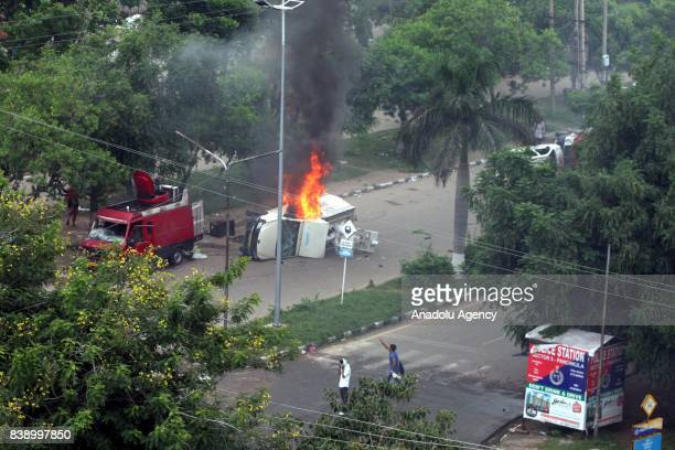 A burning vehicle is seen after Dera followers fire up the vehicles in Panchkula sector 4 after the Dera chief verdict at CBI court on August 25 2017...