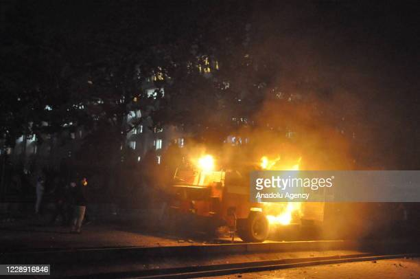 Burning vehicle is seen as protesters occupied the presidential palace and parliament building in Kyrgyzstanâs capital early Tuesday, angry over the...
