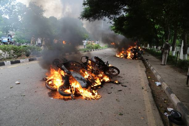 Burning vehicles are seen after Dera followers fire up the vehicles in Panchkula sector 4 after the Dera chief verdict at CBI court on August 25 2017.