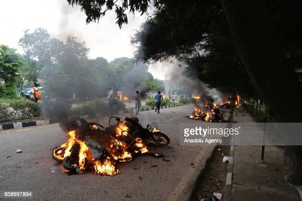 Burning vehicles are seen after Dera followers fire up the vehicles in Panchkula sector 4 after the Dera chief verdict at CBI court on August 25 2017...